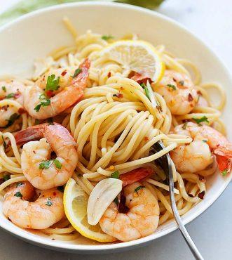 Shrimp scampi in a white serving plate, ready to serve.